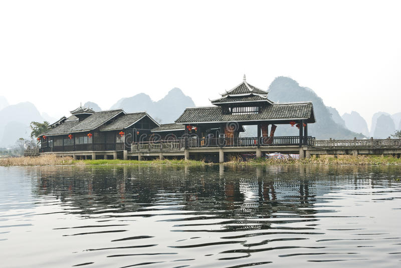 Minority style buildings, Yangshuo, Baishai, Guilin, China. The minority cultures style buildings of Miao, Dong, Zhang and Yao stock photo