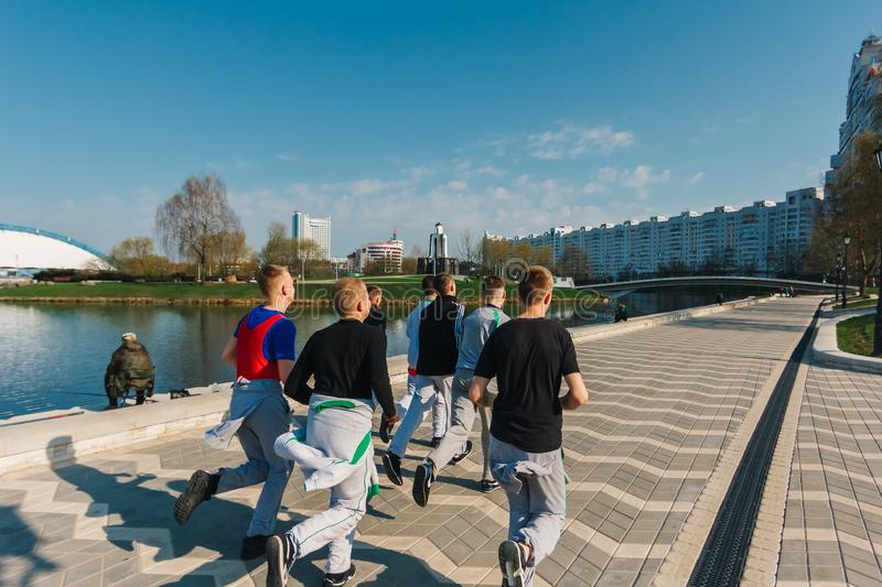 Minsk, Belarus - 21 April 2018. A group of teenagers make a morning run through the city, a healthy lifestyle, sports royalty free stock photos