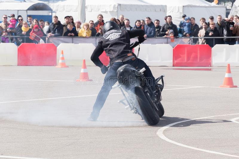 MINSK, BELARUS - APRIL 24, 2016 HOG. Harley Owners Group opening driving season show. Professional rider drifting with brand new b. MINSK, BELARUS - APRIL 24 stock images