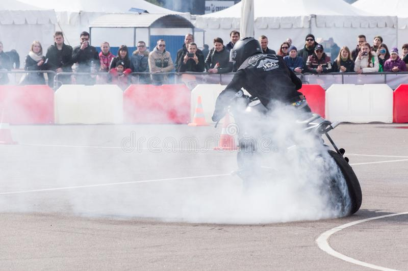 MINSK, BELARUS - APRIL 24, 2016 HOG. Harley Owners Group opening driving season show. Professional rider drifting with brand new b. MINSK, BELARUS - APRIL 24 stock photo