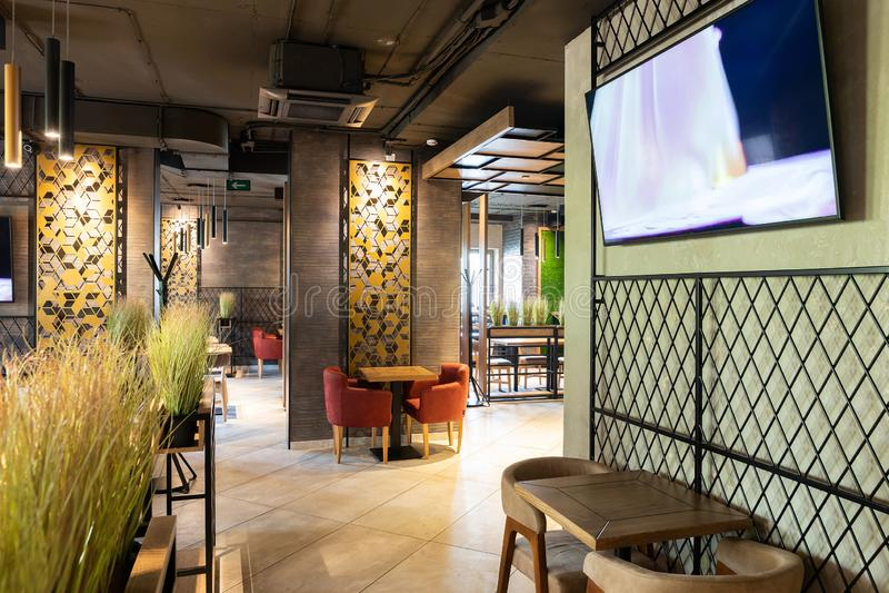 Minsk, Belarus - April 26, 2019: interior shot of modern restaurant. Luxury restaurant in contemporary style with exquisite modern furniture stock photo