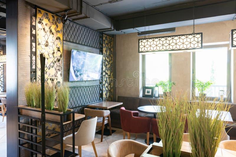Minsk, Belarus - April 26, 2019: interior shot of modern restaurant. Luxury restaurant in contemporary style with exquisite modern furniture stock image