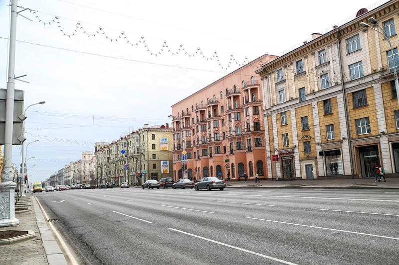 Minsk, Belarus - April 05, 2018: Modern street in Minsk city. Buildings and cars outside. Independence Avenue in Belarus. In a spring day stock images