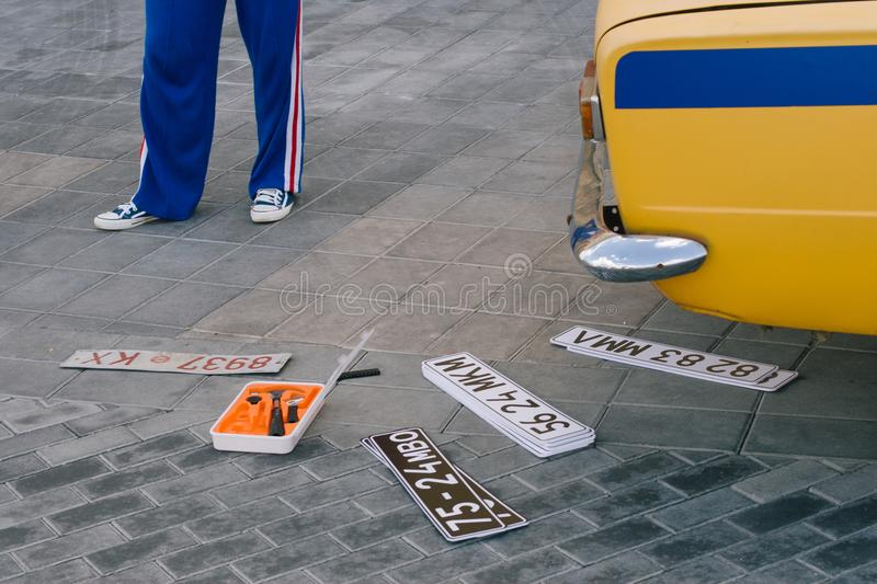 Changing car plates for movie making process, also as a concept of a car thief to go to the bank robbery or a kidnapping stock photography