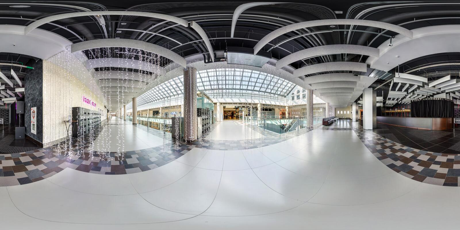 MINSK, BELARUS - AUGUST, 2016: panorama 360 degrees angle view in hall of modern trade center with several floors. Full 360 royalty free stock photography