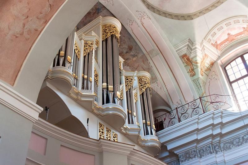 MINSK, BELARUS - AUGUST 01, 2013: Pipe organ of a Roman Catholic baroque Cathedral of Saint Virgin Mary in Minsk. The church was built in the 1710 stock photos