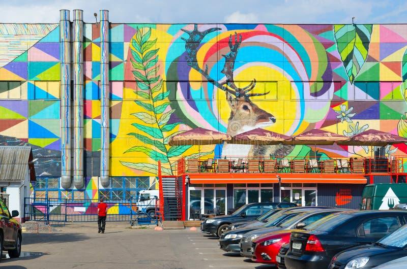 Street art on Oktyabrskaya street. Fragment of graffiti with natural motifs on wall of industrial building, Minsk, Belarus. MINSK, BELARUS - AUGUST 12, 2019 stock image