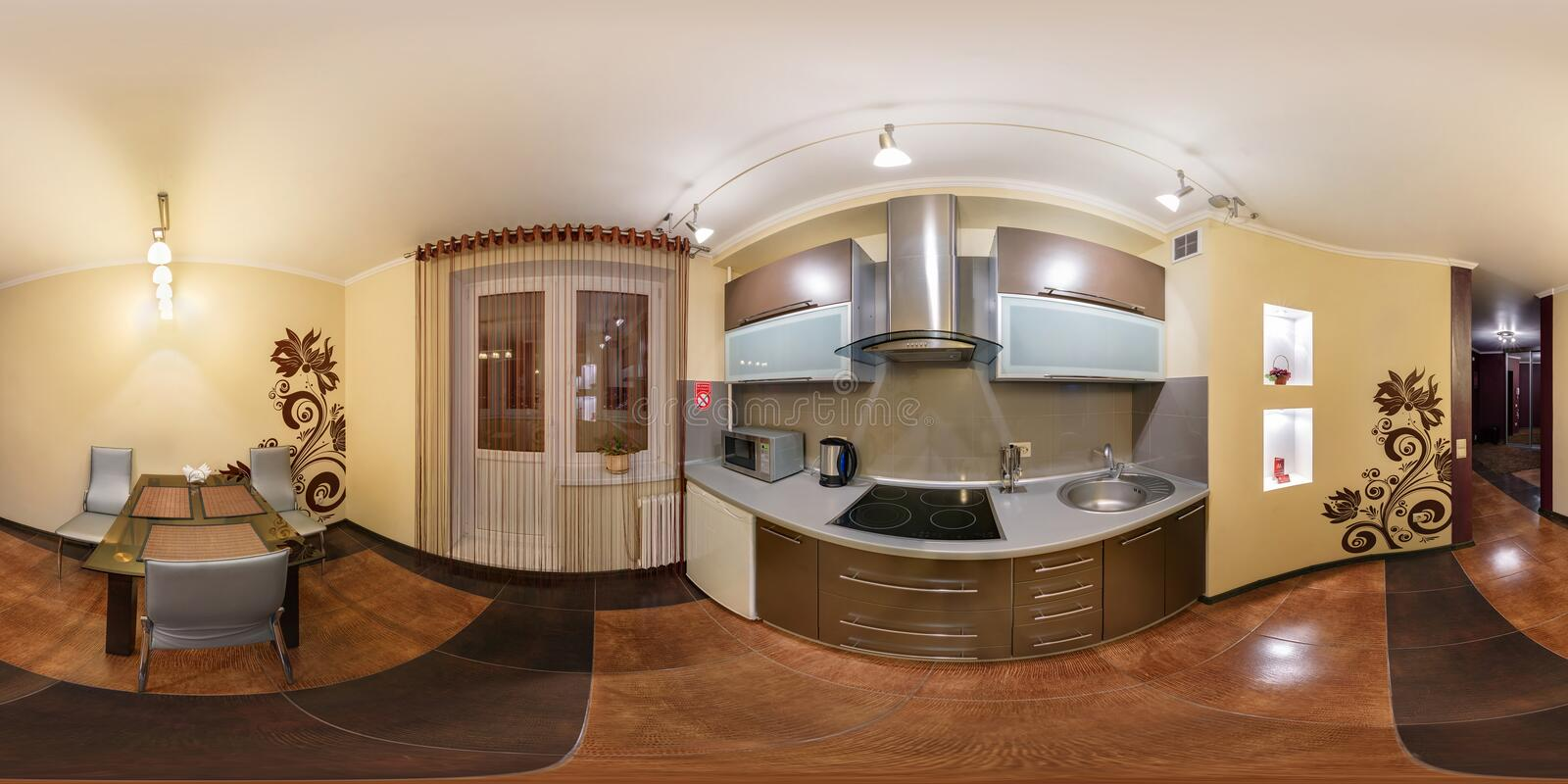 MINSK, BELARUS - DECEMBER 5, 2012: Full 360 panorama in equirectangular spherical equidistant projection in interier modern loft. Kitchen room in yellow light stock photography