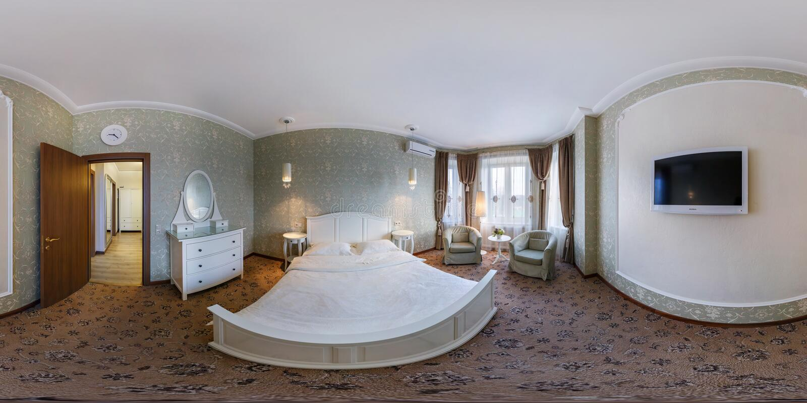 MINSK, BELARUS - FEBRUARY 27, 2014: Full spherical 360 by 180 degrees seamless panorama in equirectangular equidistant projection. Panorama in interior bedroom stock photo