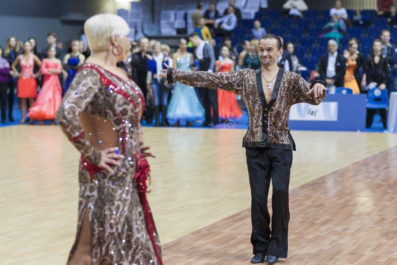 Minsk-Belarus, February, 23: Igor Sivov-Elena Sobol Perform S. Enior Latin-American Program on Open Minsk WDSF Championship 2014 on February, 23, 2014, in Minsk royalty free stock photography