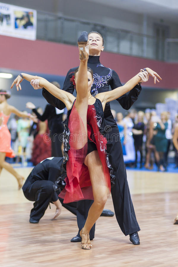 Minsk-Belarus, February, 23: Sergey Kolesnev- Anzhelika Plodunova Perform Youth-2 Latin-American Program on Open Minsk WDSF Champ stock image