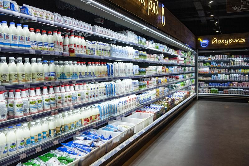Minsk, Belarus, January 12, 2019: Dairy products on the shelves in the supermarket. stock photography