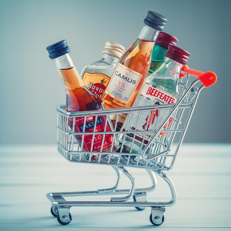 Minsk, Belarus - January 16, 2018: Illustrative editorial photo of mini shopping cart full of small alcohol bottles. stock photo