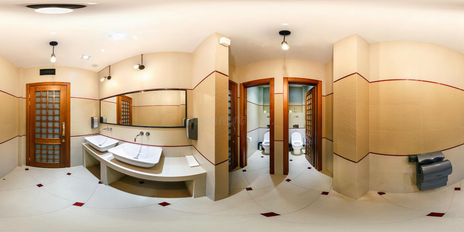 MINSK, BELARUS - JANUARY 25, 2015: Panorama in interior stylish bathroom restroom in modern office. Full 360 degree seamless stock images