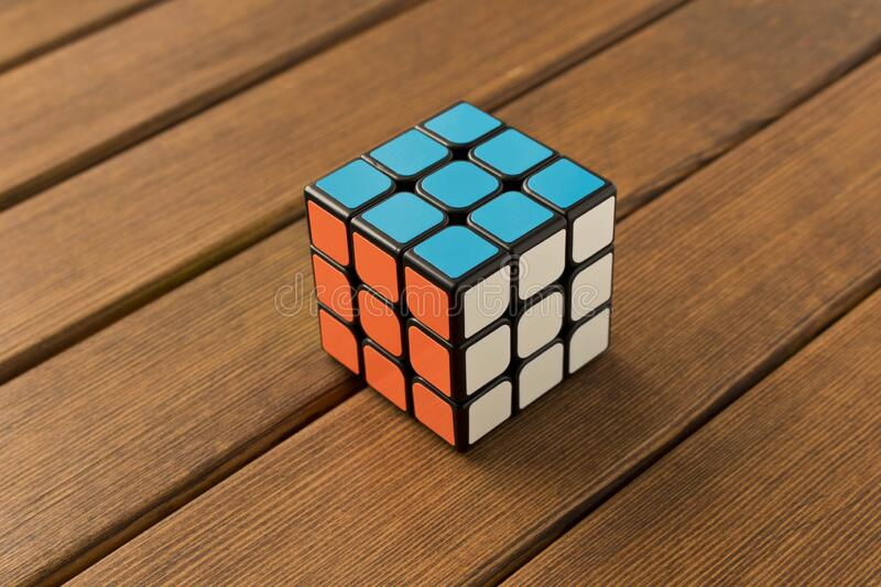 Minsk, Belarus, January 15, 2020. Rubik`s cube on a wooden table.  stock photography
