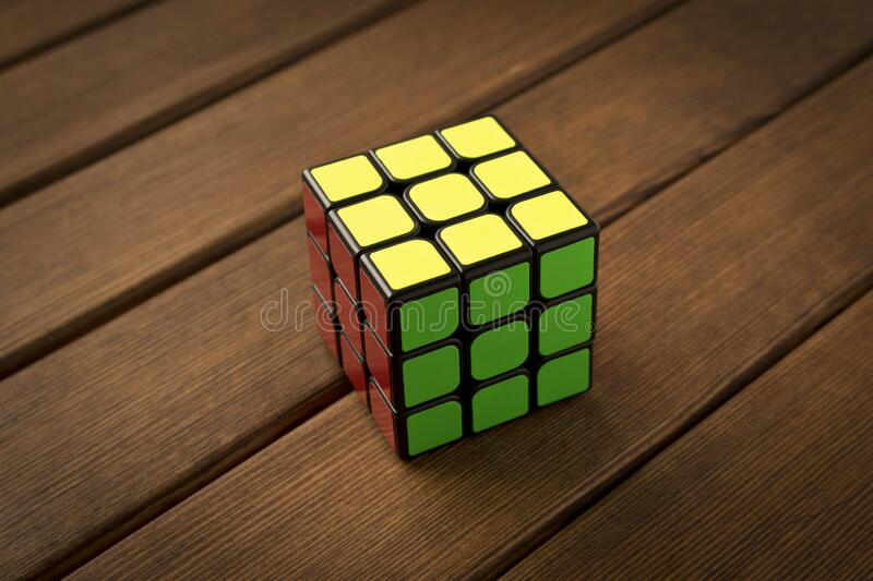 Minsk, Belarus, January 15, 2020. Rubik`s cube on a wooden table.  stock images