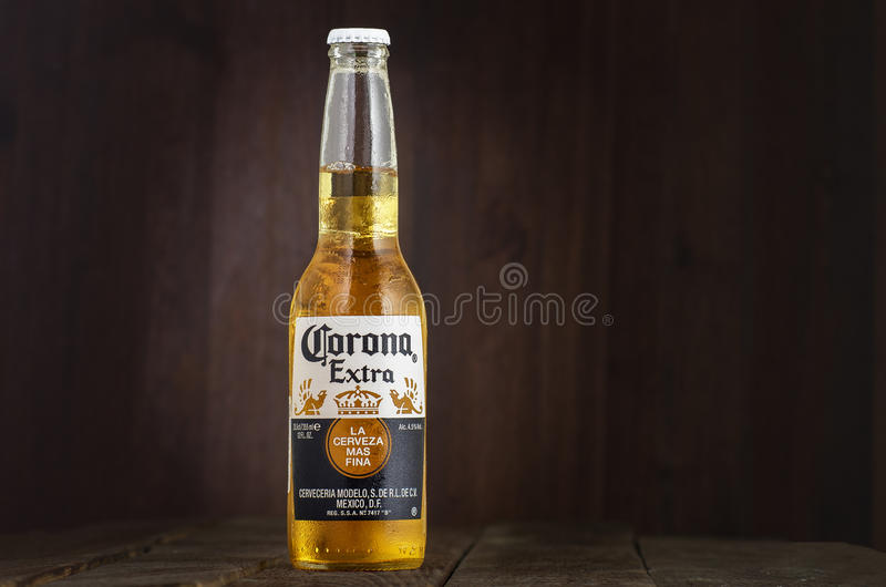 MINSK, BELARUS - JULY 10, 2017: Editorial photo of bottle of Corona Extra beer on wood background, one of the top royalty free stock photo