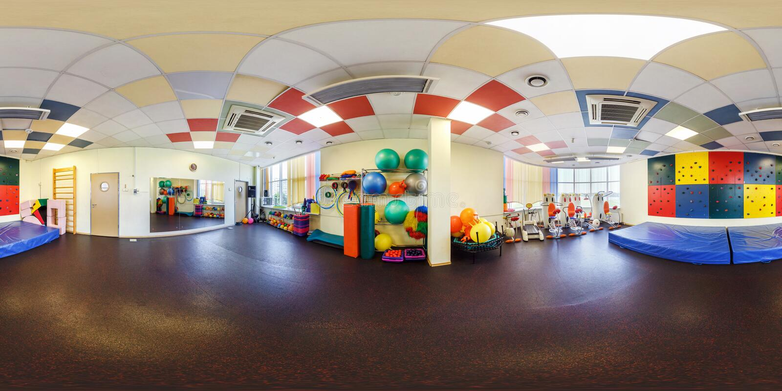 MINSK, BELARUS - JULY, 2017: full seamless panorama 360 angle view in interior of stylish fitness club for kids gymnastics room royalty free stock image