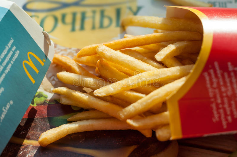Minsk, Belarus, june 6, 2017: burger and french fries in a McDonald`s restaurant. stock photography