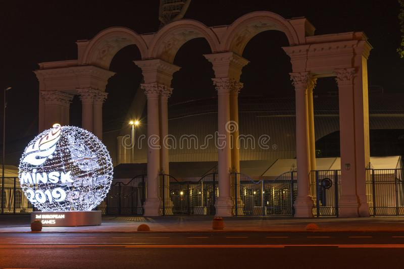 Minsk, Belarus, June 9, 2019. 2 European Games. Light ball with the logo of European games near the entrance to the. Sports stadium, photographed at night royalty free stock image