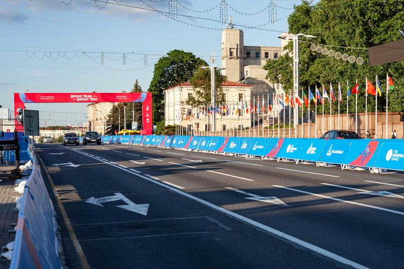 Minsk, Belarus, June 22, 2019: Finish of the distance of sports competitions and flags of the countries participating in the 2ND E. Finish of the distance of royalty free stock image