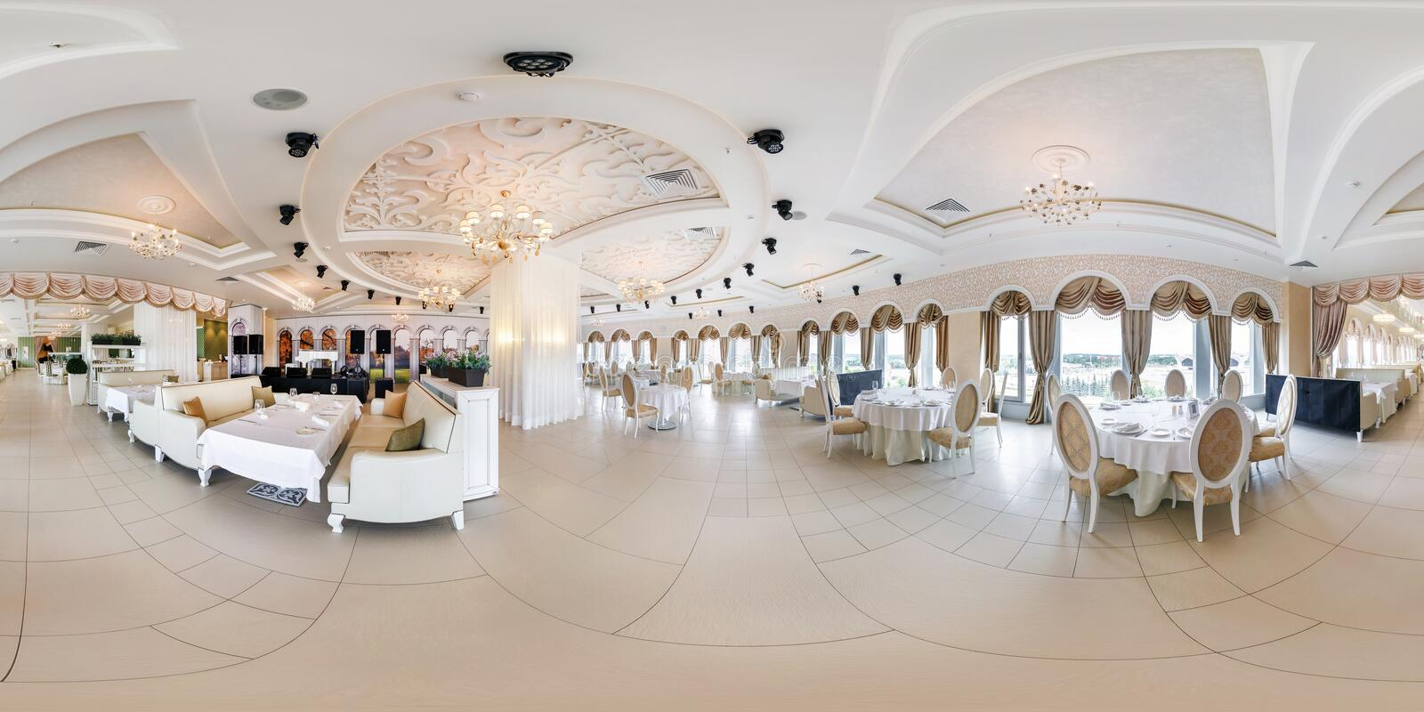 MINSK, BELARUS - JUNE, 2015: Full spherical seamless panorama 360 degrees angle view in interior of stylish modern restaurant stock photography