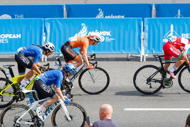 MINSK, BELARUS - 22 June 2019: 2nd European Games Women`s cycle road race. Athlets is on home stretch.  royalty free stock images