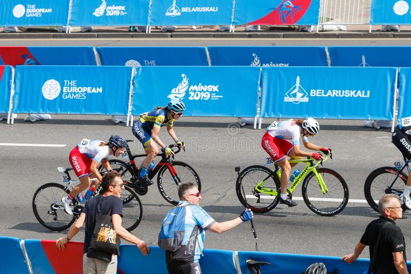 MINSK, BELARUS - 22 June 2019: 2nd European Games Women`s cycle road race. Athlets is on home stretch.  royalty free stock photography