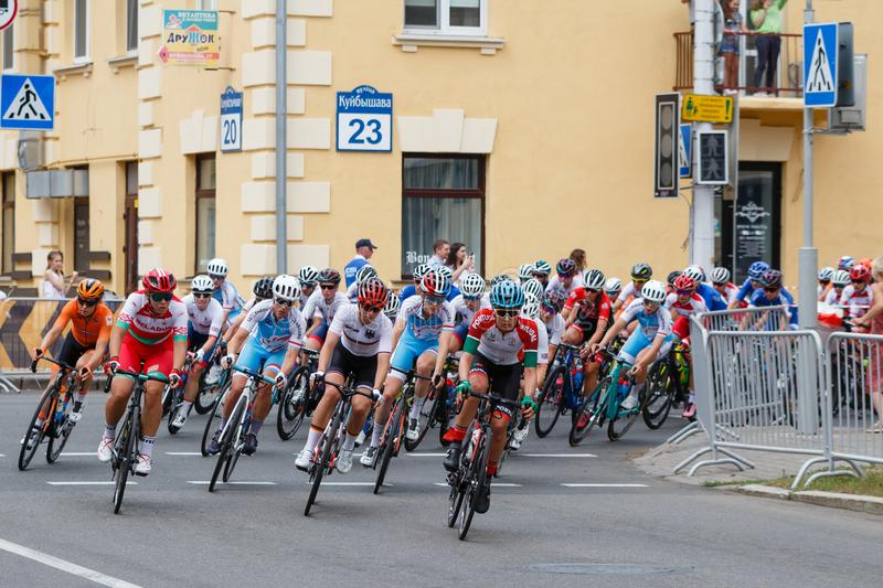 MINSK, BELARUS - 22 June 2019: 2nd European Games Women`s cycle road race. Cyclists going round a corner.  royalty free stock images