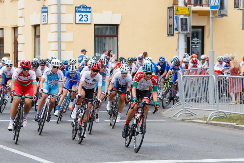 MINSK, BELARUS - 22 June 2019: 2nd European Games Women`s cycle road race. Cyclists going round a corner.  stock photos