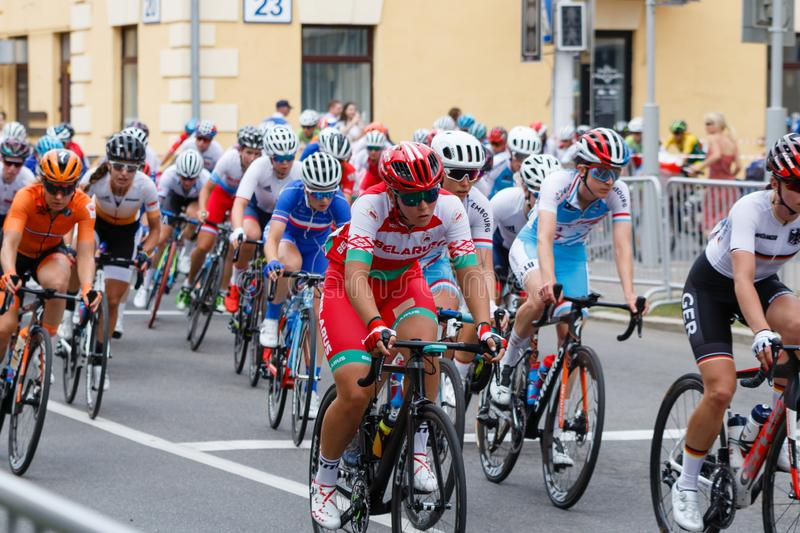 MINSK, BELARUS - 22 June 2019: 2nd European Games Women`s cycle road race. Cyclists going round a corner.  stock photo