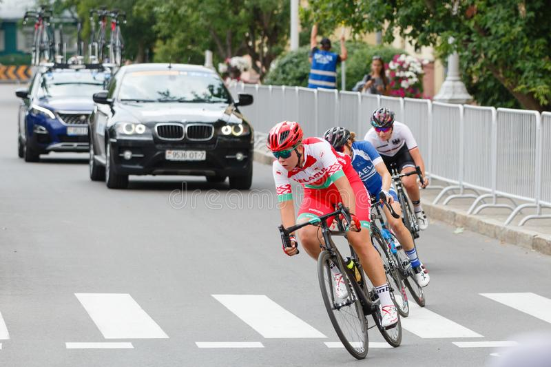 MINSK, BELARUS - 22 June 2019: 2nd European Games Women`s cycle road race. Cyclists going round a corner.  royalty free stock image