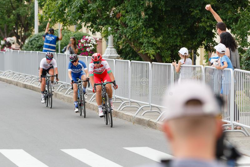 MINSK, BELARUS - 22 June 2019: 2nd European Games Women`s cycle road race. Cyclists going round a corner.  royalty free stock photos