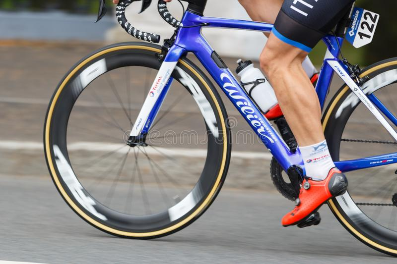 MINSK, BELARUS - 22 June 2019: 2nd European Games Women`s cycle road race. View on spinning wheels and foot on pedal.  royalty free stock photography
