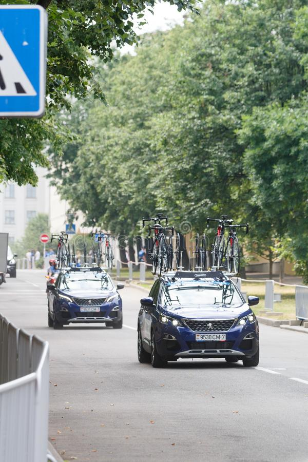 MINSK, BELARUS - 22 June 2019: 2nd European Games Women`s cycle road race. View on support units stock photos