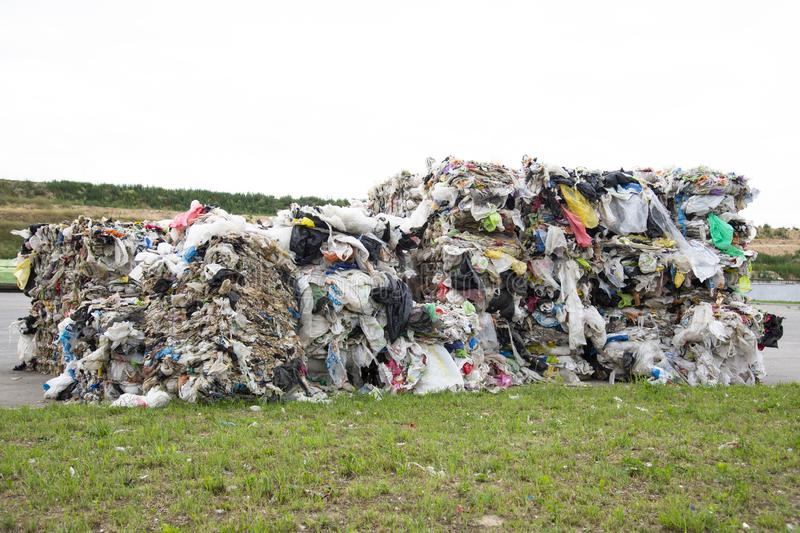 Minsk, Belarus -June 6, 2019 A pile of pressed polyethylene at a garbage collection plant. Sorting and processing of polyethylene royalty free stock photo