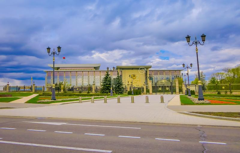 MINSK, BELARUS - MAY 01, 2018: Blurred view of the Palace of the Republic is a Belarusian cultural and business center. Located on the October Square of Minsk stock image