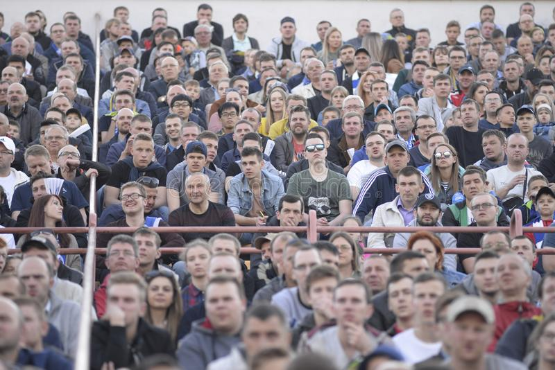 MINSK, BELARUS - MAY 23, 2018: Fans looks game during the Belarusian Premier League football match between FC Dynamo Minsk and FC. Bate at the Tractor stadium royalty free stock photography