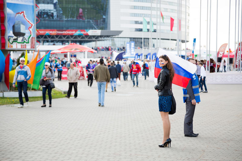MINSK, BELARUS - MAY 9 - Woman with Russian Flag in Front of Minsk Arena on May 9, 2014 in Belarus. Ice Hockey Championship. MINSK, BELARUS - MAY 9 - Woman with royalty free stock image