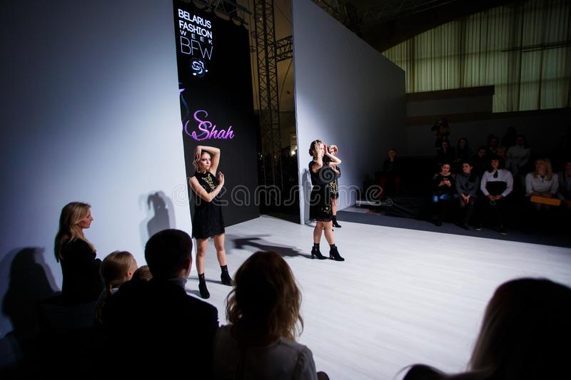 Three girls posing for pictures at Fashion Week on Kids Day stock image