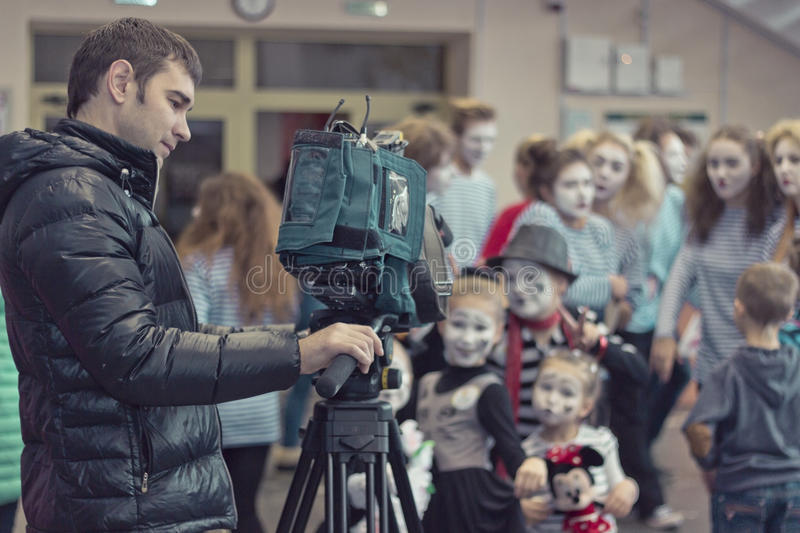 Minsk, Belarus - November 11, 2016: Video operator removes the children at the camera royalty free stock photos