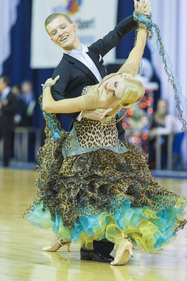 Minsk-Belarus, October 5, 2014: Professional dance Couple of Dulebenec Egor and Samorodskaya Alexandra performing Adult Standard. Program on World Open Minsk stock photography