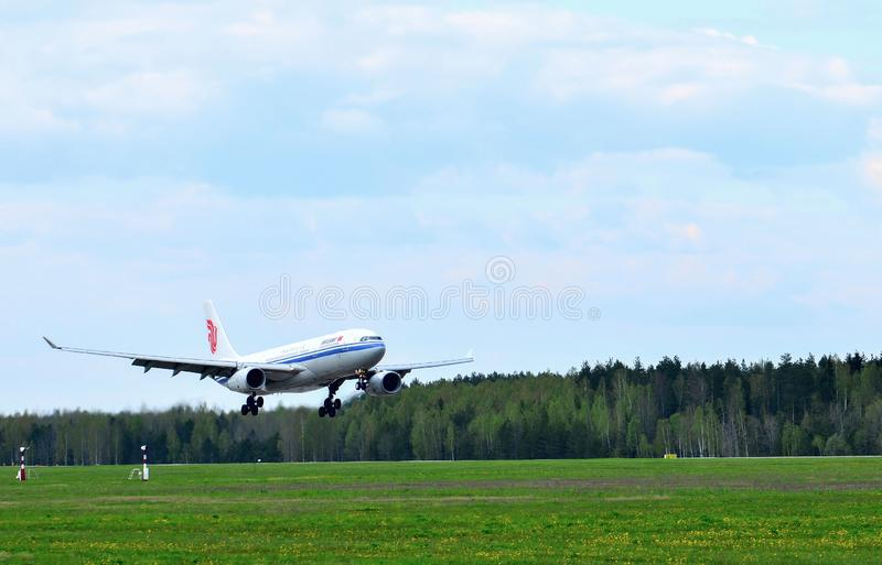 The passenger plane Airbus A330 of the airline China Air lands at the National Airport Minsk stock photography