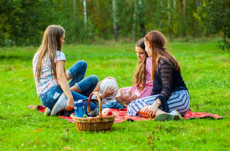 Minsk, Belarus - September 21, 2018: Friends group of young teenager girls having fun together on grass royalty free stock image