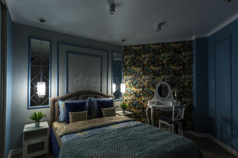MINSK, BELARUS - SEPTEMBER, 2019: Interior of the modern luxure intimate bedroom with fireplace in studio apartments.  royalty free stock photography