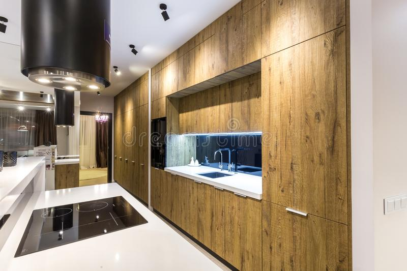 MINSK, BELARUS - SEPTEMBER, 2019: Interior of the modern luxure vip kitchen with guest table in studio apartments.  royalty free stock image