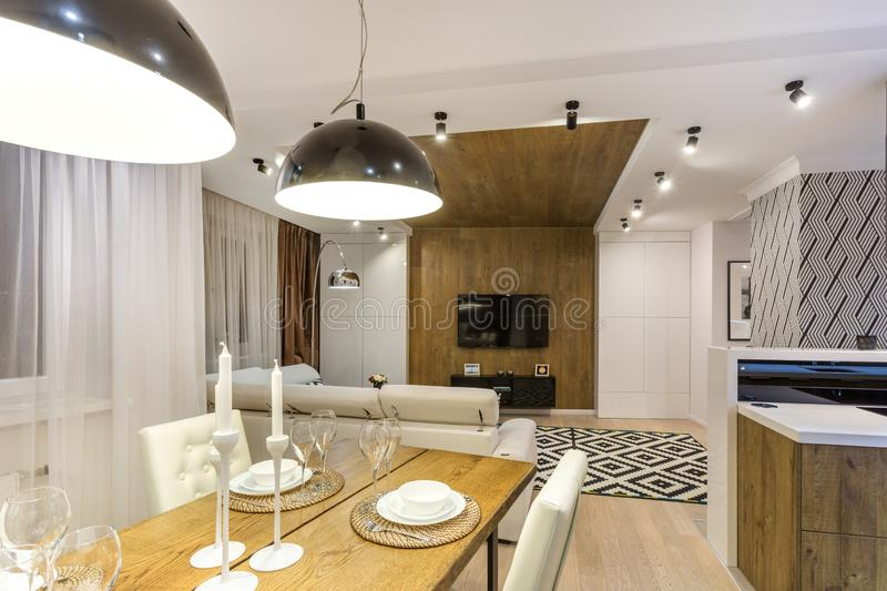 MINSK, BELARUS - SEPTEMBER, 2019: Interior of the modern luxure vip kitchen with guest table in studio apartments.  stock image