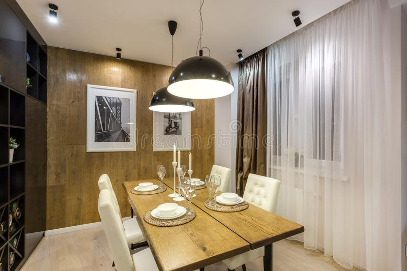 MINSK, BELARUS - SEPTEMBER, 2019: Interior of the modern luxure vip kitchen with guest table in studio apartments.  stock photography