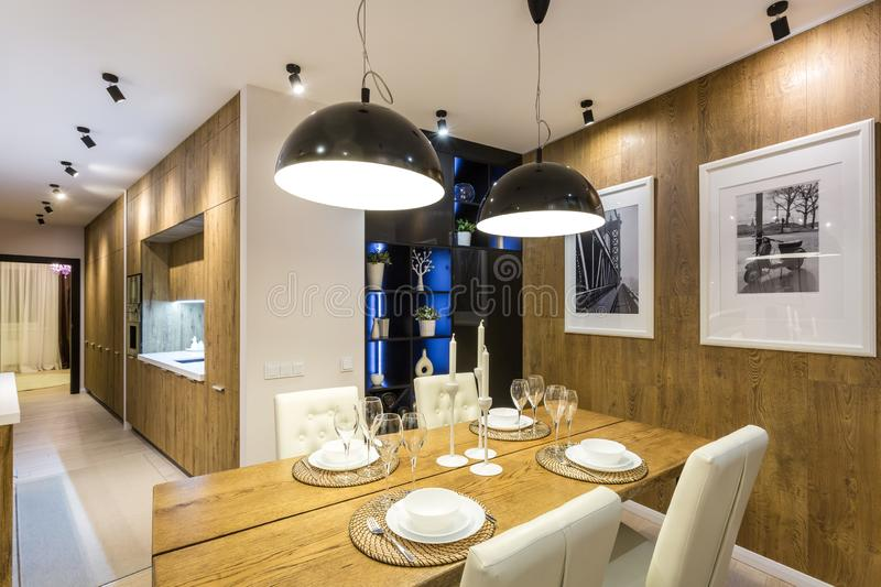 MINSK, BELARUS - SEPTEMBER, 2019: Interior of the modern luxure vip kitchen with guest table in studio apartments.  stock images