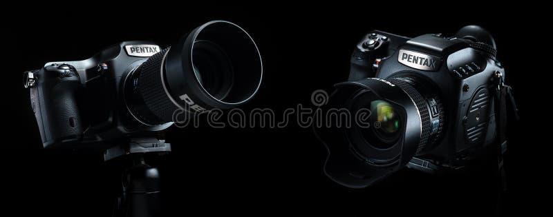 Minsk, Belarus, September 6, 2018: Pentax 645Z medium format cam. Era over black background stock photos